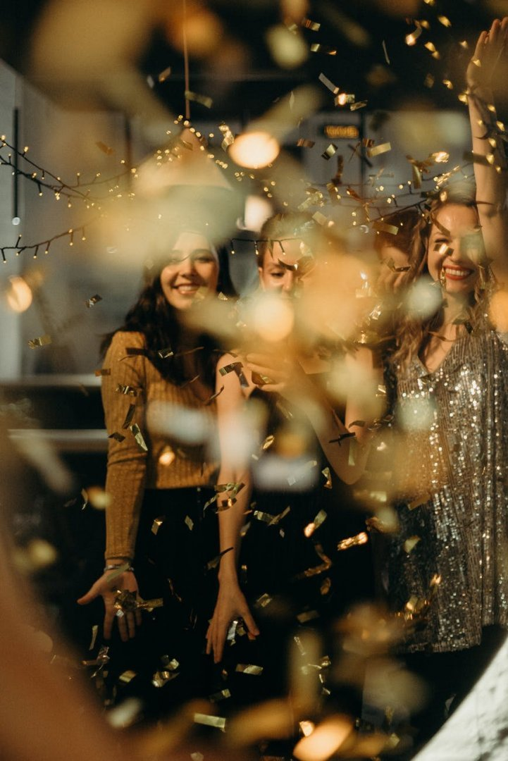 Women partying with confetti