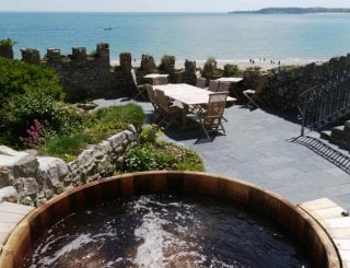 Cedar hot tub with a view to Caldey Island