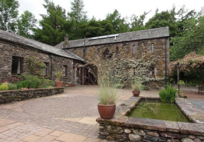 Land Ends lodge, courtyard and fishpond