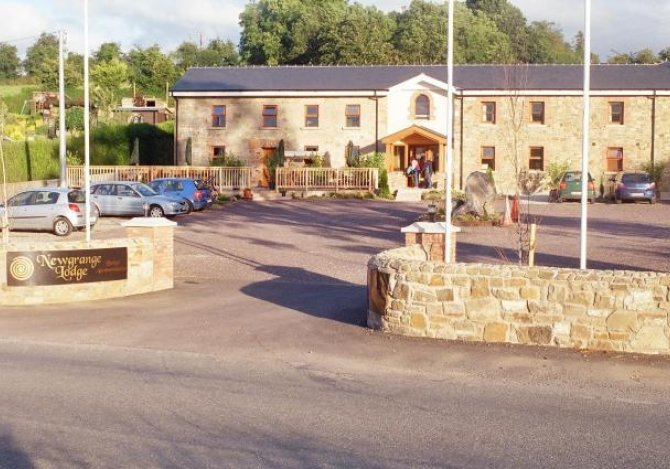 Front View of the Lodge with Large Parking Area