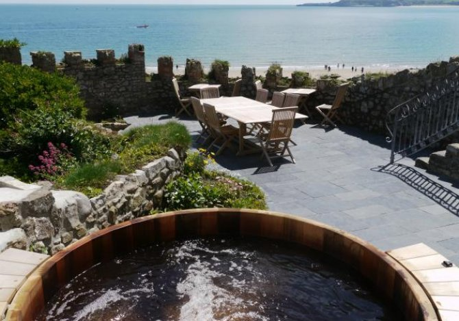 Cedar hot tub with a view to Caldey Island