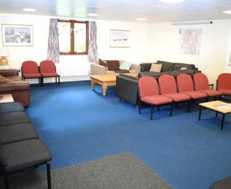 Large communal room with 4 sofas and open space