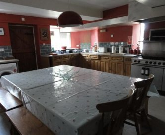 Large kitchen to seat 16 with six burner gas range