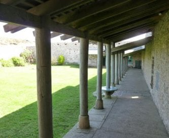 Covered walkway around courtyard garden