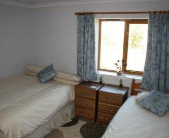 Room 1 has a double & single bed/en-suite wet room