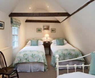 The attic room has views across to distant hills
