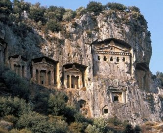 Ancient rock tombs carved into rock face