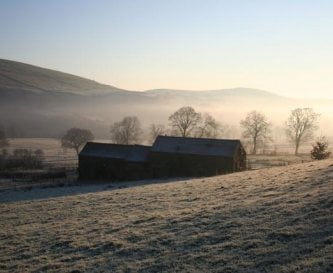 The barns in the early morning mist