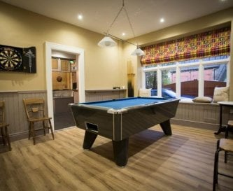Games room- tablefootball, dart board & pool table