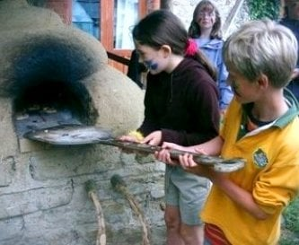 Making pizzas outside on cob oven