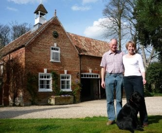Paul, Flora and Jessie in front of the Coach House
