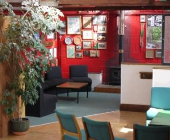 Comfy area and woodburner in the recreation room