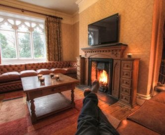 Lounge with huge Chesterfield sofas and open fire.