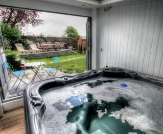 Bannerrigg 8 seat hot tub in its own building.