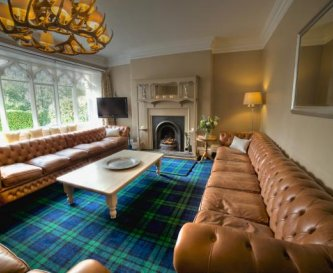 Bannerrigg lounge with huge Chesterfield sofas.
