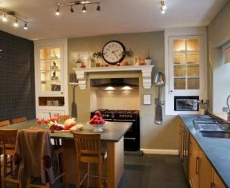 Boston House kitchen with range cooker and island.