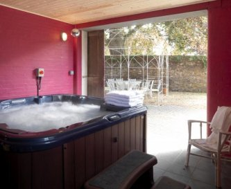 Eight person hot tub in the coach house