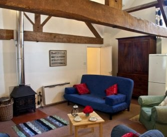 Spacious sitting/dining room in Coach House