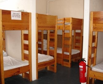 24 bed = 10 per dorm & 2 side doubles