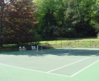 The all weather tennis court provides great fun