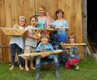 Children work together to produce works of art