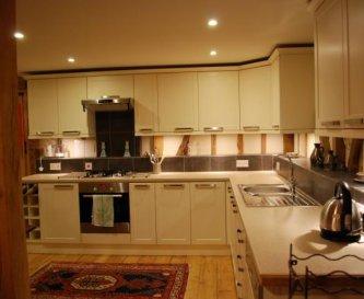 Open plan kitchen leading to lounge Virginia Barn
