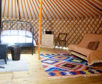 Yurt interior - double bed and double futon