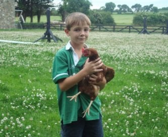 Child with chicken at Decoy Country Cottages