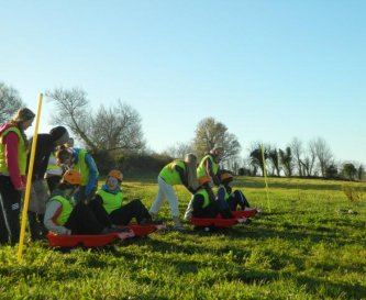 Youths taking part in Grass Sledging