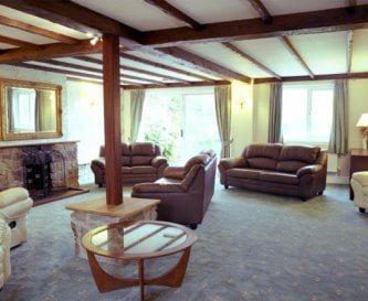 Large lounge with patio door opening onto terrace