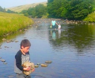 Paddling in the ford near Cautley Spout