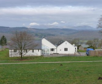 Bungalow with Windermere and fells beyond.