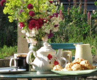 Tea under the balcony, flowers from the garden