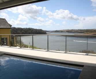 Indoor infinity edge saltwater pool - superb views