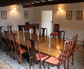 Dining table for 16 in front of the Inglenook.
