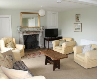 Relax in one of two comfortable sitting rooms.