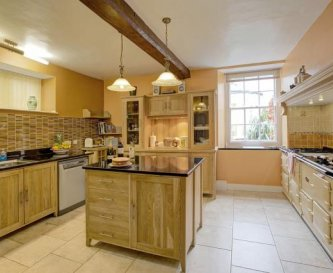 Traditional oak kitchen with Supersized Aga