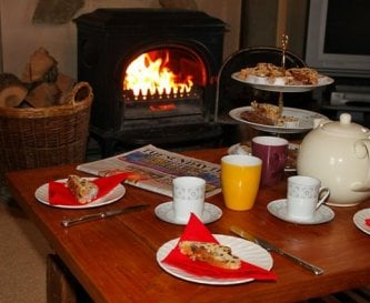 Cosy up and relax with tea by the woodburner