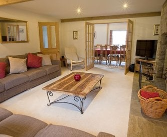 Lounge with lots of seating and log fire