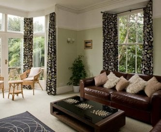 Sitting room with french doors and balcony