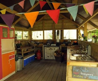 Well equipped, shared camp kitchen.