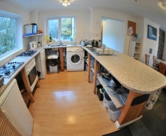 Large, well-equipped open-plan kitchen