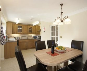 Gorgeous kitchen with oak units and table too!