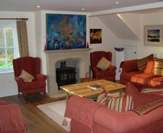 Guest Lounge with woodburner stove, TV, DVD & VCR