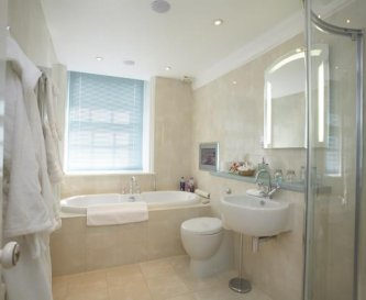 Master en-suite with deep bath, shower & TV