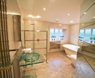 Family bathroom with freestanding bath & wet room.