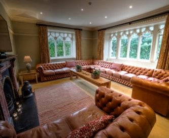 The lounge with huge Chesterfield sofas.