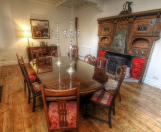 Majestic dining room with wood-burner, seats 12.