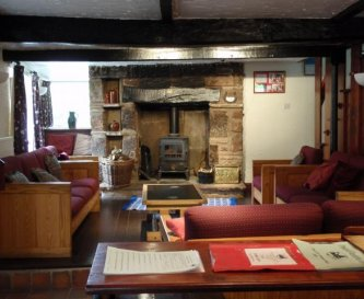 The living room with wood-burning stove