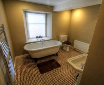 En-suite bedroom 1. with Victorian bath and shower